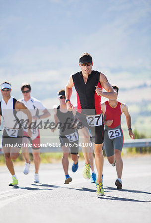 Runners in race on rural road Stock Photo - Premium Royalty-Free, Image code: 6113-06754100