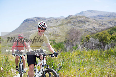 mountain bikers on dirt path Stock Photo - Premium Royalty-Free, Image code: 6113-06754101