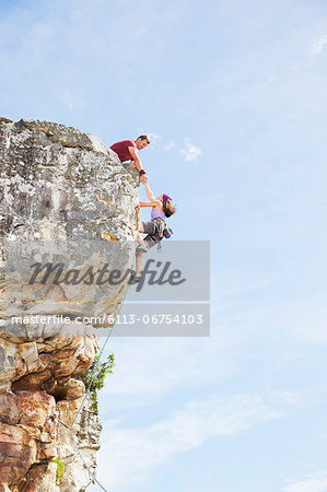 Climbers scaling steep rock face Stock Photo - Premium Royalty-Free, Image code: 6113-06754103
