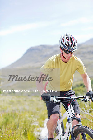mountain biker on dirt path Stock Photo - Premium Royalty-Free, Image code: 6113-06754113