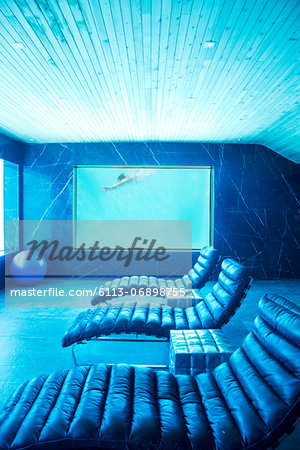 Room view of woman swimming underwater Stock Photo - Premium Royalty-Free, Image code: 6113-06898755