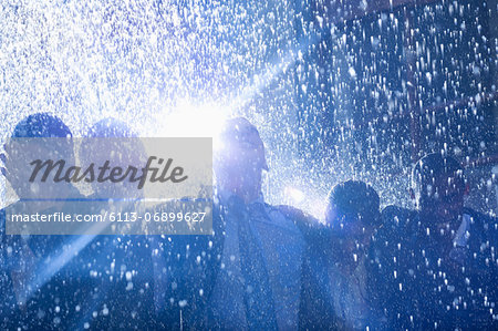 Business people in rain Stock Photo - Premium Royalty-Free, Image code: 6113-06899627