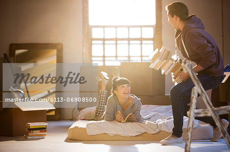 Couple relaxing in attic Stock Photo - Premium Royalty-Free, Image code: 6113-06908500