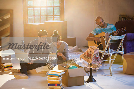 Friends relaxing in new home Stock Photo - Premium Royalty-Free, Image code: 6113-06908569