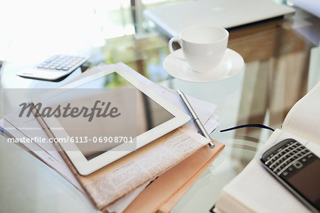 Tablet computer, newspaper, coffee cup and cell phone on desk Stock Photo - Premium Royalty-Free, Image code: 6113-06908701