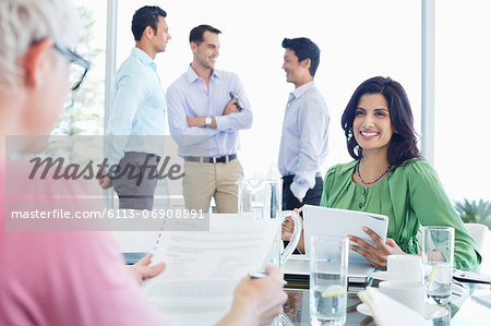 Business women talking in meeting Stock Photo - Premium Royalty-Free, Image code: 6113-06908891