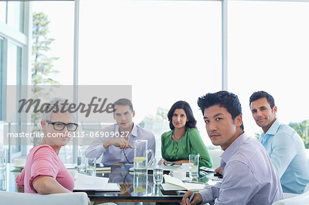 Business people sitting in meeting Stock Photo - Premium Royalty-Free, Image code: 6113-06909027