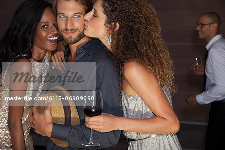 Friends relaxing together at party Stock Photo - Premium Royalty-Free, Image code: 6113-06909090