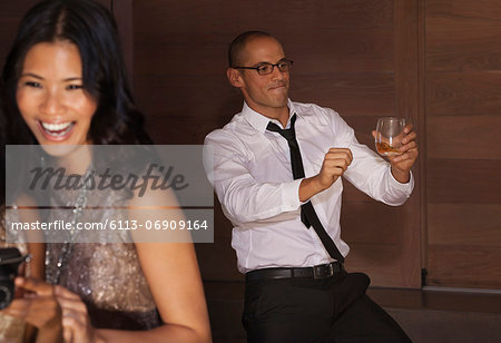 Man dancing at party Stock Photo - Premium Royalty-Free, Image code: 6113-06909164