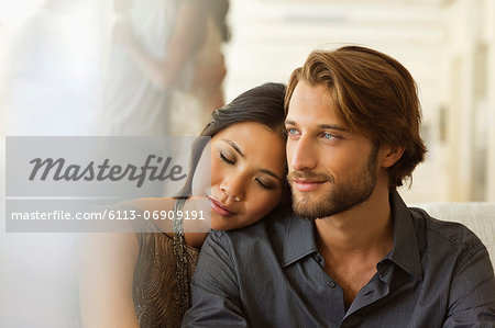 Couple hugging indoors Stock Photo - Premium Royalty-Free, Image code: 6113-06909191