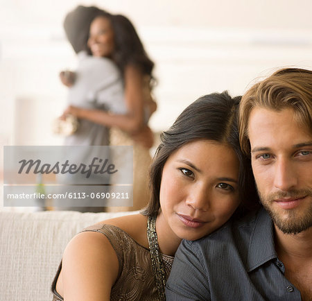 Couple hugging on sofa Stock Photo - Premium Royalty-Free, Image code: 6113-06909211