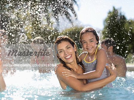 Mother and daughter in swimming pool Stock Photo - Premium Royalty-Free, Image code: 6113-06909306