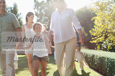 Family walking together in backyard Stock Photo - Premium Royalty-Free, Image code: 6113-06909335