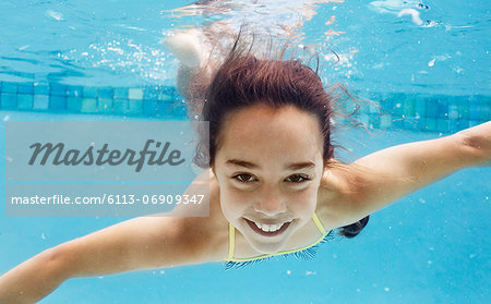 Girl swimming in pool Stock Photo - Premium Royalty-Free, Image code: 6113-06909347