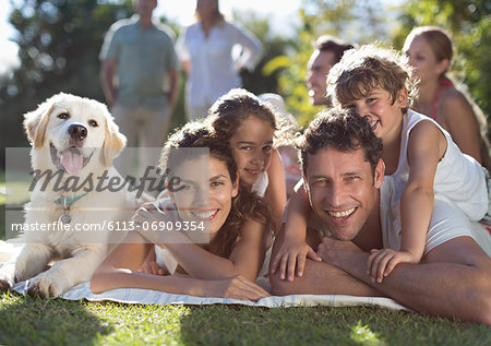 Family relaxing in backyard Stock Photo - Premium Royalty-Free, Image code: 6113-06909354