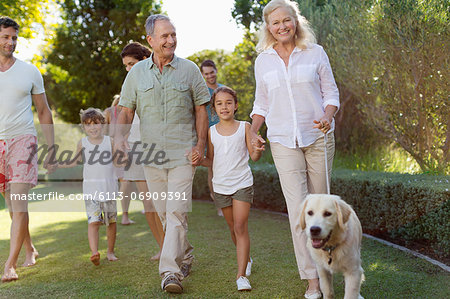 Family walking together in park Stock Photo - Premium Royalty-Free, Image code: 6113-06909391