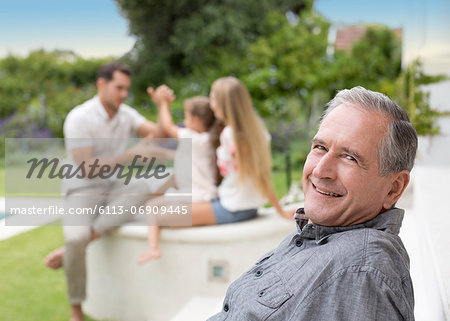 Older man smiling outdoors Stock Photo - Premium Royalty-Free, Image code: 6113-06909445