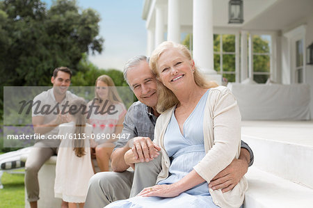 Older couple smiling on porch