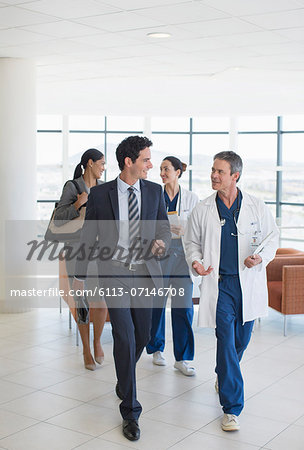 Doctors and administrators talking in hospital Stock Photo - Premium Royalty-Free, Image code: 6113-07146708