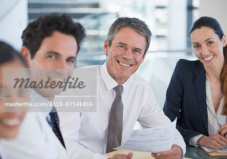 Portrait of smiling doctors and business people in meeting Stock Photo - Premium Royalty-Free, Image code: 6113-07146816