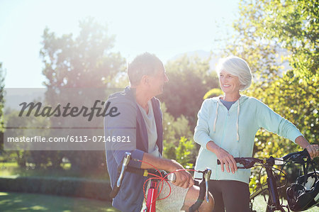 Senior couple with bicycles in park