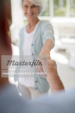 Senior couple dancing on patio Stock Photo - Premium Royalty-Free, Image code: 6113-07146865