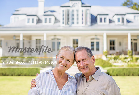 Portrait of smiling senior couple in front of house Stock Photo - Premium Royalty-Free, Image code: 6113-07146938