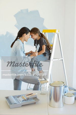 Mother and daughter painting wall blue Stock Photo - Premium Royalty-Free, Image code: 6113-07147151