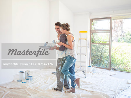 Couple painting walls Stock Photo - Premium Royalty-Free, Image code: 6113-07147176