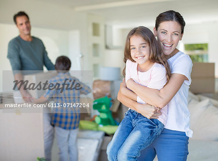 Mother and daughter hugging in new house Stock Photo - Premium Royalty-Free, Image code: 6113-07147204