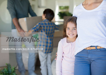 Family moving into new house Stock Photo - Premium Royalty-Free, Image code: 6113-07147238
