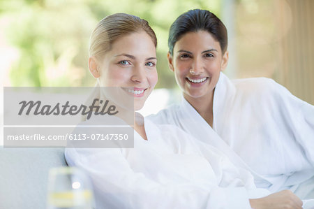 Portrait of smiling women in bathrobes at spa Stock Photo - Premium Royalty-Free, Image code: 6113-07147350