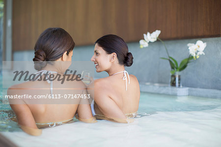Women relaxing together in spa pool Stock Photo - Premium Royalty-Free, Image code: 6113-07147453