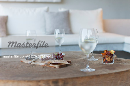 Wine and cheese on wooden coffee table Stock Photo - Premium Royalty-Free, Image code: 6113-07147606