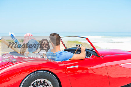 Family driving convertible to beach Stock Photo - Premium Royalty-Free, Image code: 6113-07147706
