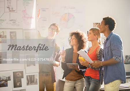 Business people talking in office Stock Photo - Premium Royalty-Free, Image code: 6113-07147835
