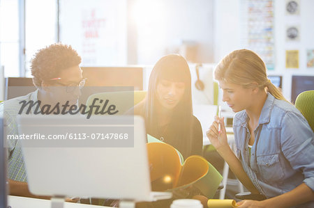 Business people talking in office Stock Photo - Premium Royalty-Free, Image code: 6113-07147868