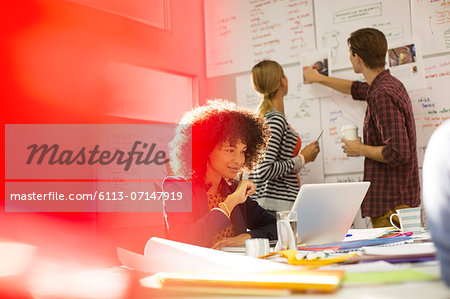 Business people working in office Stock Photo - Premium Royalty-Free, Image code: 6113-07147919