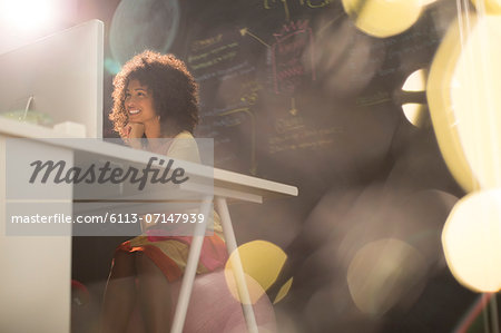 Businesswoman at desk in office Stock Photo - Premium Royalty-Free, Image code: 6113-07147939