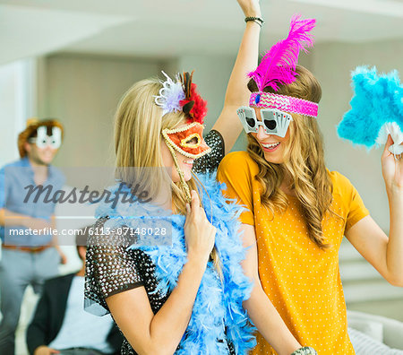 Women wearing decorative glasses and headpieces at party Stock Photo - Premium Royalty-Free, Image code: 6113-07148028