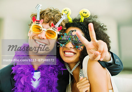 Couple wearing decorative glasses at party Stock Photo - Premium Royalty-Free, Image code: 6113-07148072