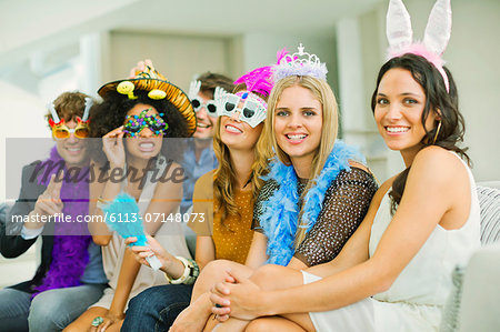 Friends wearing decorative glasses and headpieces at party Stock Photo - Premium Royalty-Free, Image code: 6113-07148073