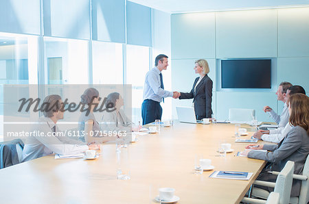 Business people shaking hands in meeting Stock Photo - Premium Royalty-Free, Image code: 6113-07158963