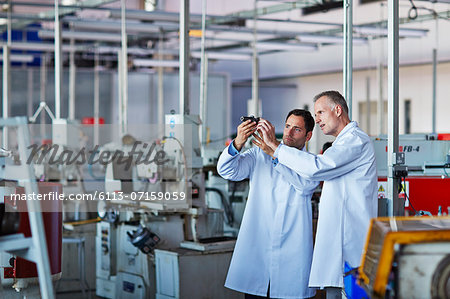 Scientists working in laboratory Stock Photo - Premium Royalty-Free, Image code: 6113-07159059