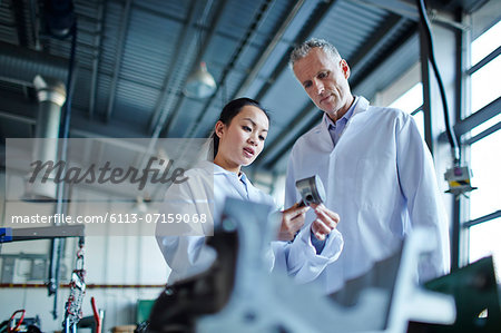 Scientists working in laboratory Stock Photo - Premium Royalty-Free, Image code: 6113-07159068