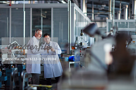 Scientists working in laboratory Stock Photo - Premium Royalty-Free, Image code: 6113-07159084