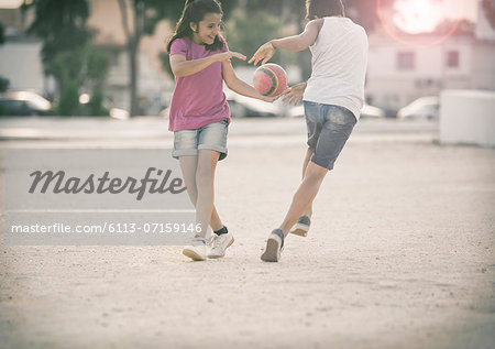 Children playing in sand Stock Photo - Premium Royalty-Free, Image code: 6113-07159146