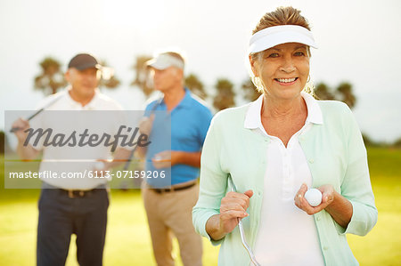 Senior friends on golf course Stock Photo - Premium Royalty-Free, Image code: 6113-07159206