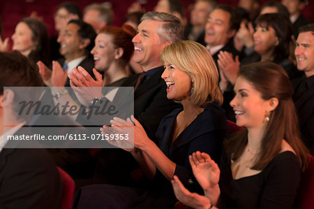 Clapping theater audience Stock Photo - Premium Royalty-Free, Image code: 6113-07159353