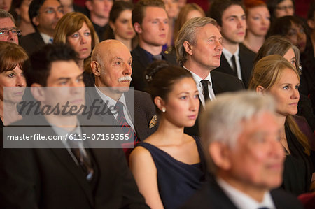 Serious theater audience Stock Photo - Premium Royalty-Free, Image code: 6113-07159355
